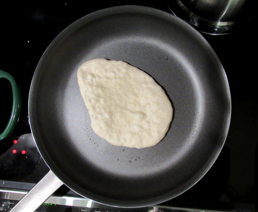 naan cooking in skillet